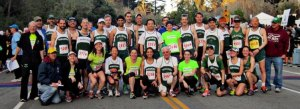The Pamakids gather for their traditional pre-race photo before the 2013 KP Half Marathon. Photo by Paul Mosel.